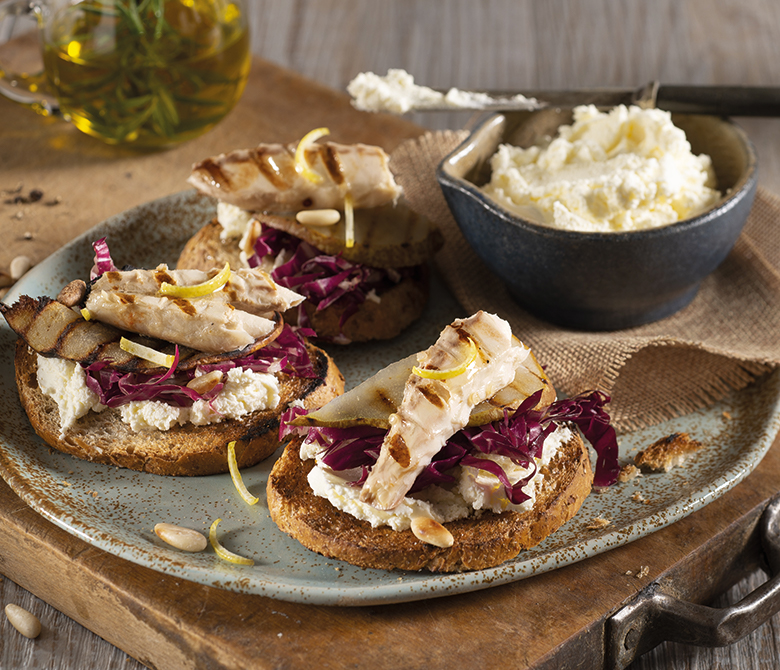 Rye bread crostini topped with pears and mackerel fillets
